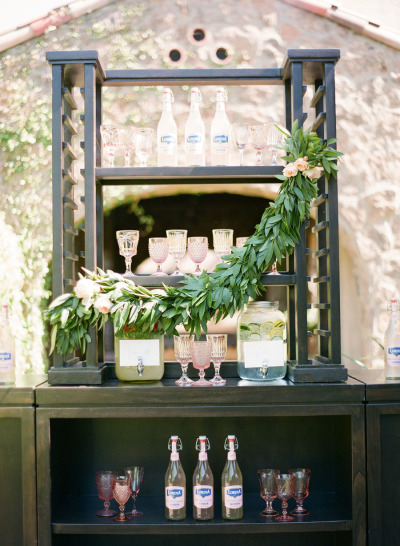 wedding outdoor bar with greenery styling