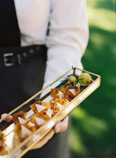server serving appetizers at a wedding