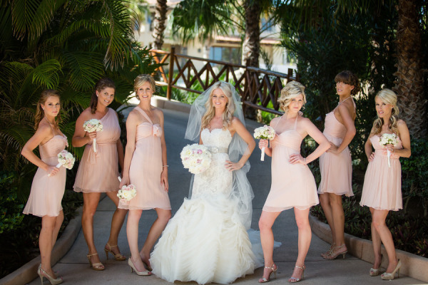 bride and bridesmaids making funny poses