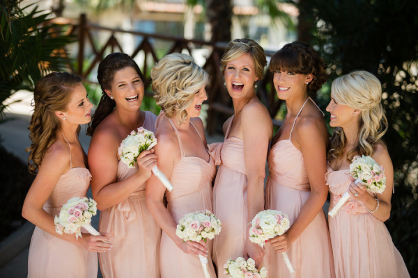bridesmaids laughing in peach short dresses