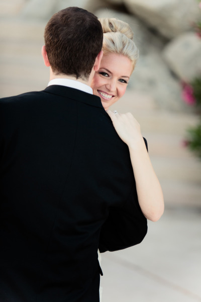 bride smiling during the first dance, bride's hair in a bun