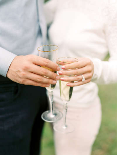 couple toasting with champagne flutes after proposal