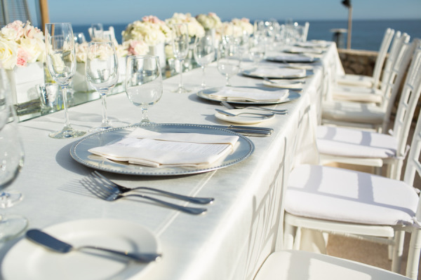 white wedding reception tablescape by the ocean
