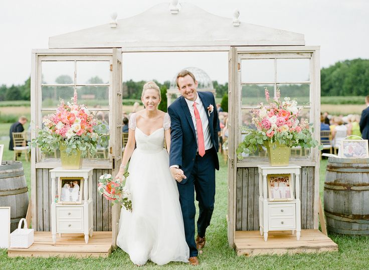bride and groom walking down the aisle after ceremony under vintage window decor