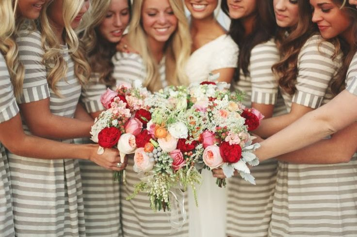 bridesmaids holding flowers together