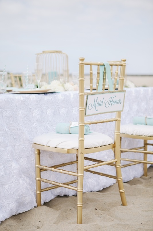 gold reception chair with Maid of Honor sign