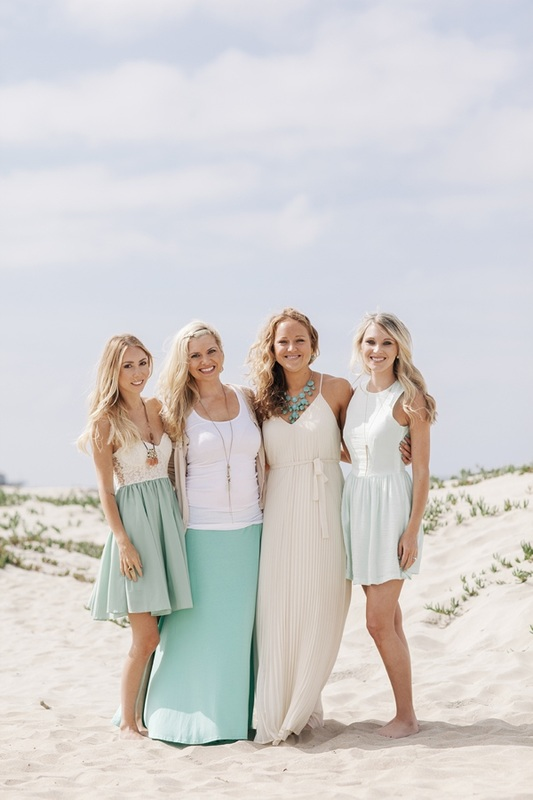 girls in white and blue dresses on sand dunes