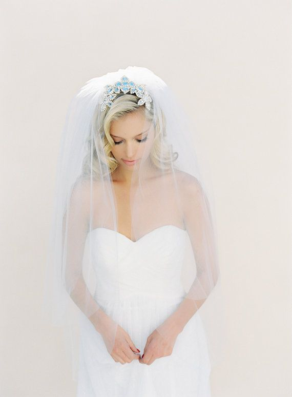 bride with gorgeous curls under veil