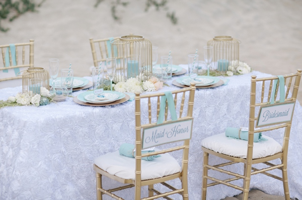 gold chiavari wedding reception chairs, seaside reception table