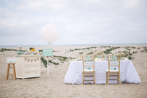 reception table on sand dunes