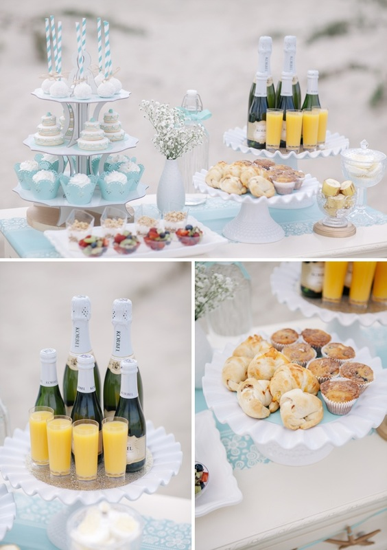 brunch table with champagne, pastries, mini cakes and fruit cups