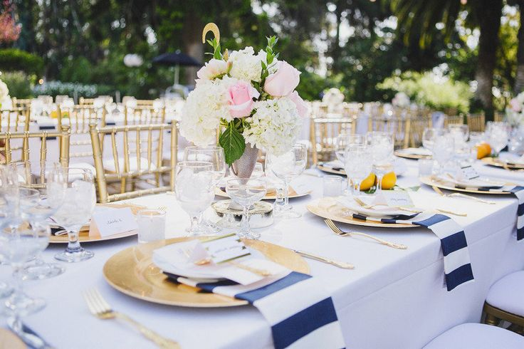 gold wedding chairs and navy striped napkins