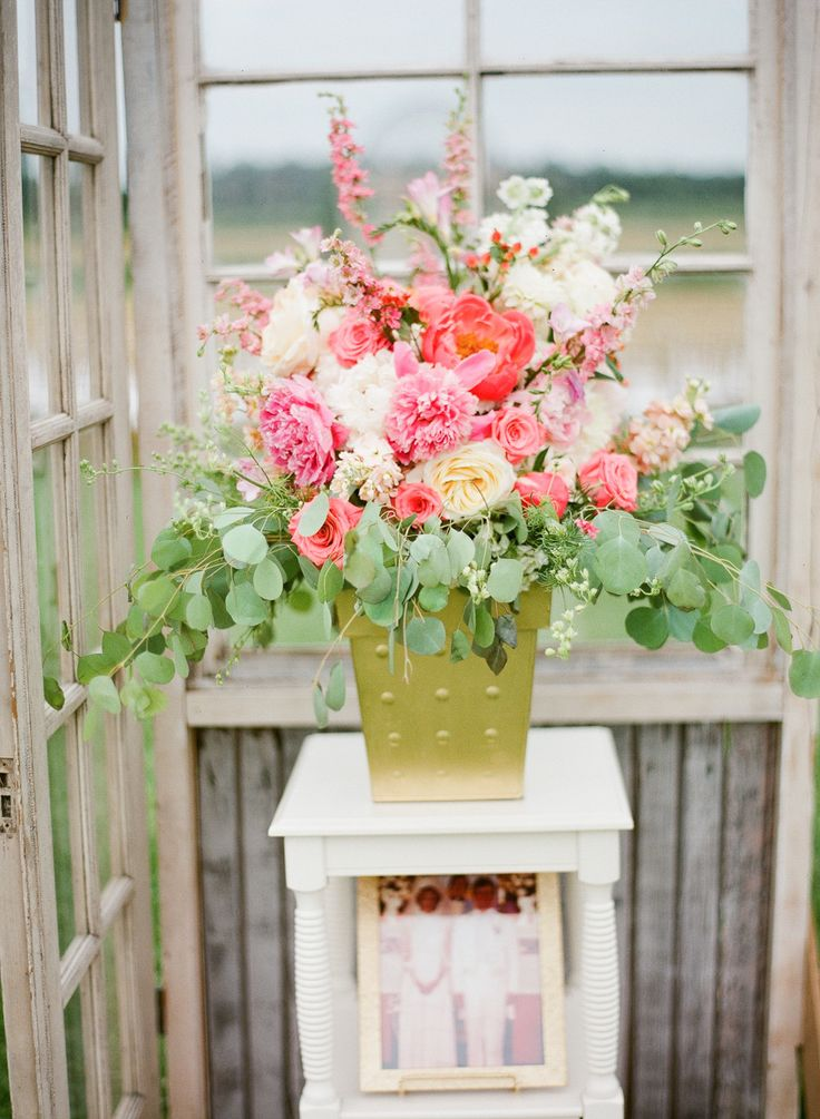 huge bouquet of coral, white and pink wedding flowers at ceremony entrance