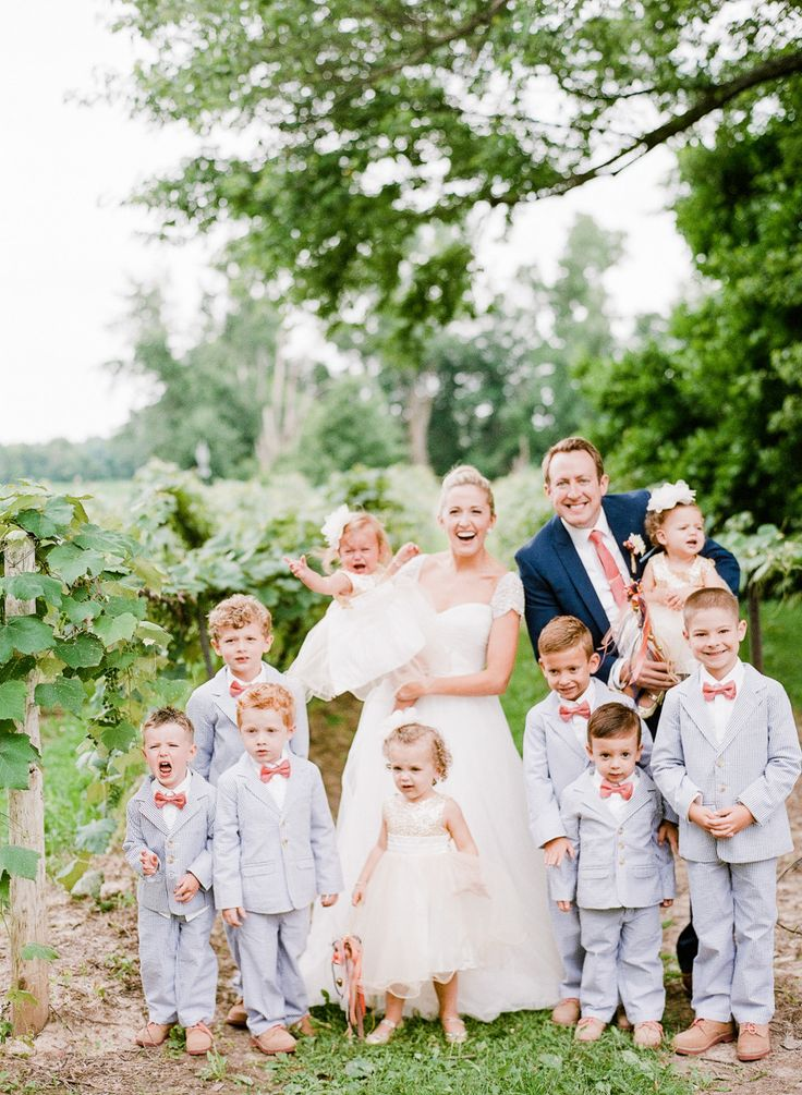 bride and groom standing with kids in preppy attire