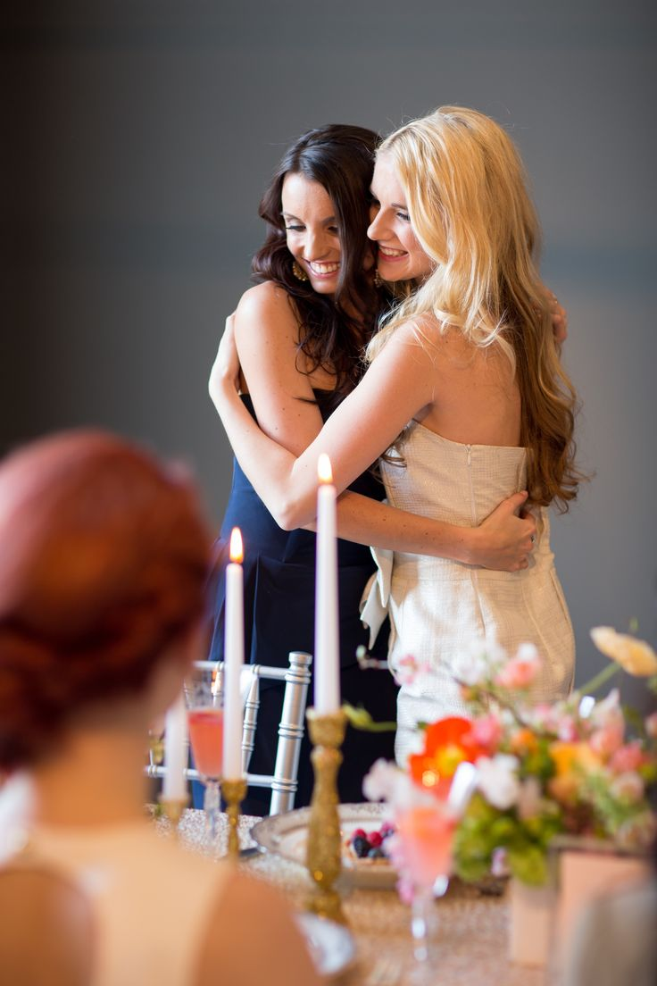 girls hugging at bridal shower brunch