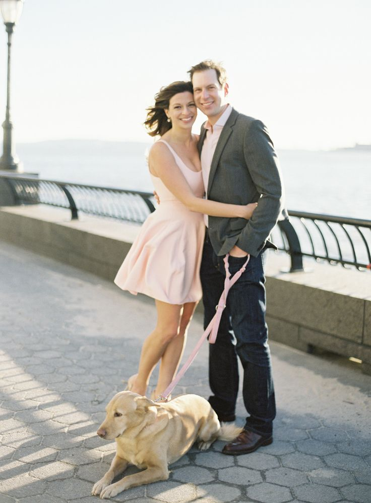engagement session along the Hudson river, girl in pink dress with cute dog