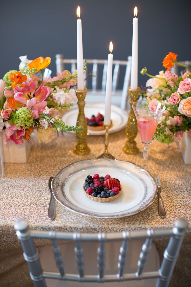 fruit tart on gold sequin linen and pink and green flowers