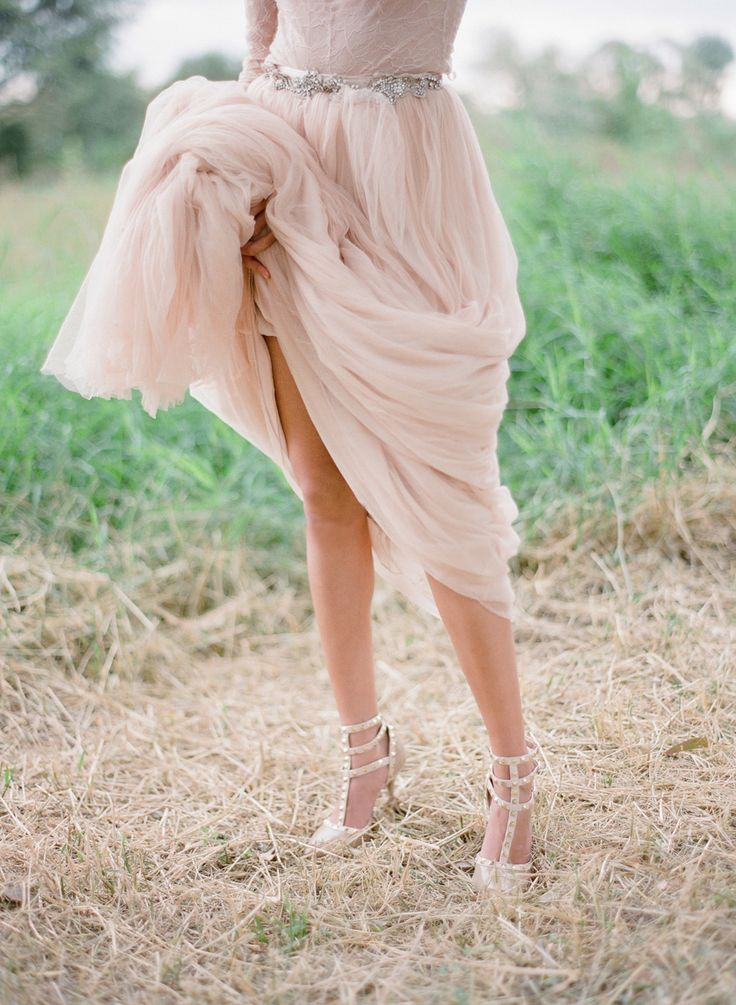 bride in nude Valentino studded wedding shoes