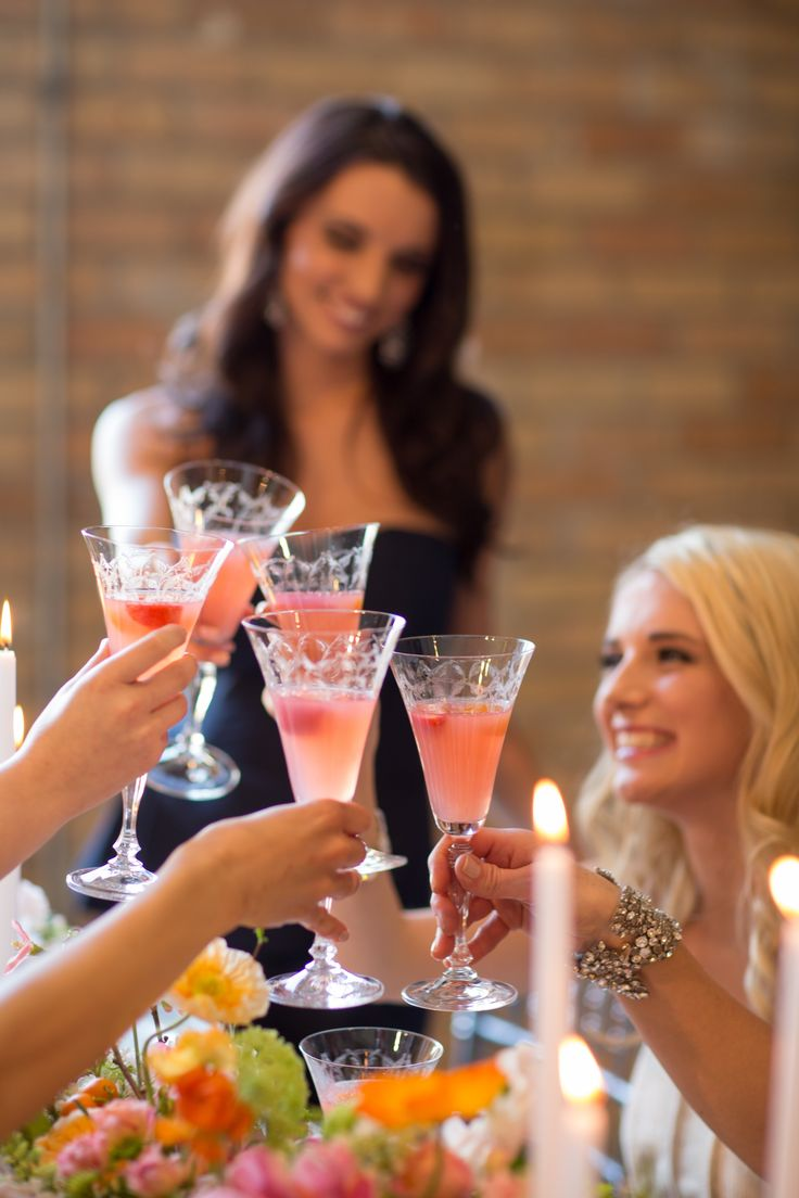 girls toasting with pink mimosas at bridal shower brunch