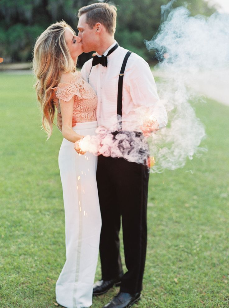 bride and groom kissing holding sparklers