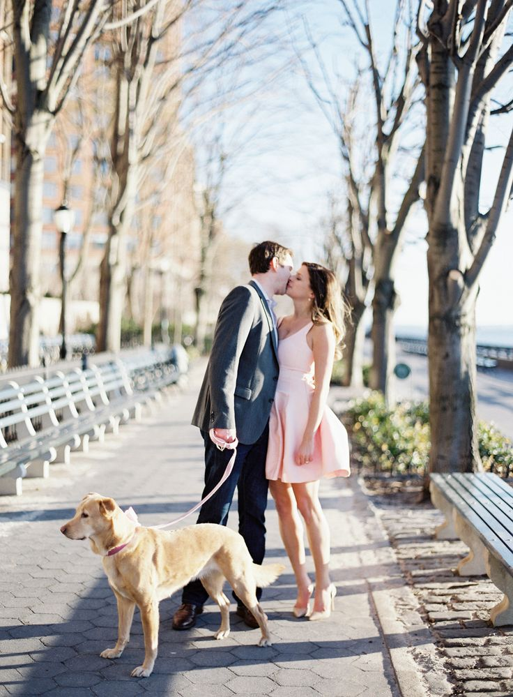 couple kissing in NYC, girl in pretty-in-pink dress, cute golden retriever