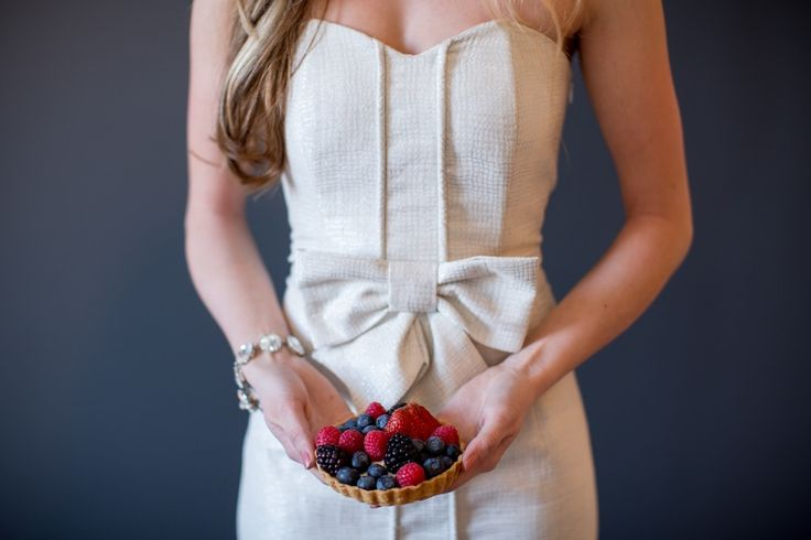 white bow dress, girl holding fruit tartlet