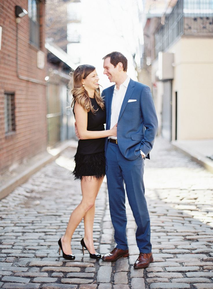 couple engagement session on cobblestone streets in NYC