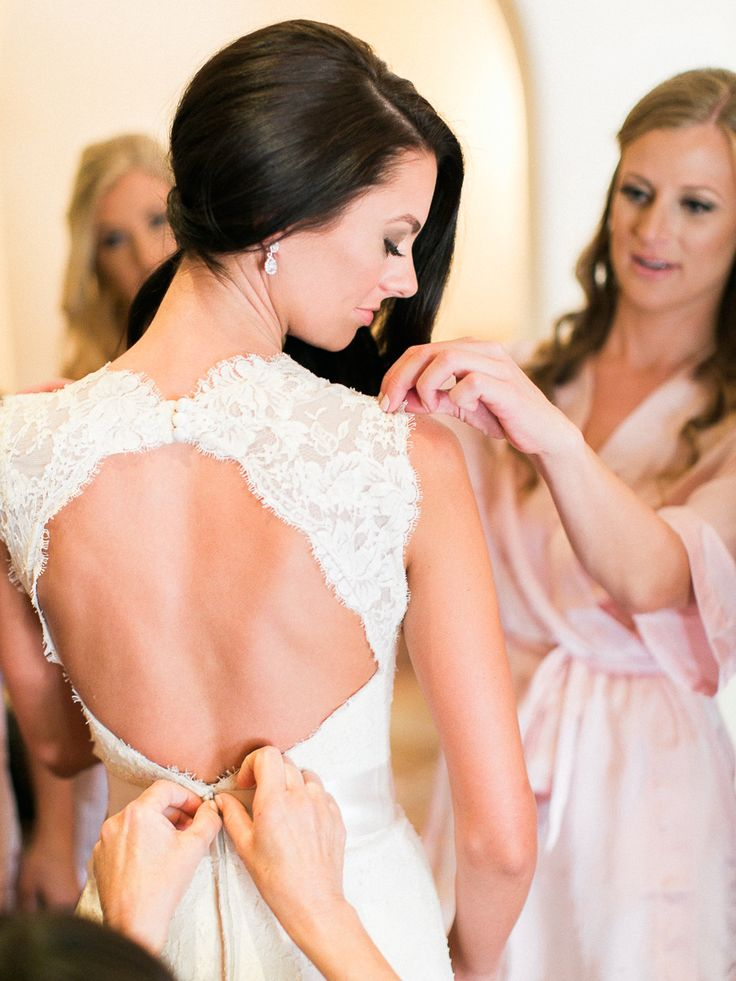 bride in wedding dress with keyhole back