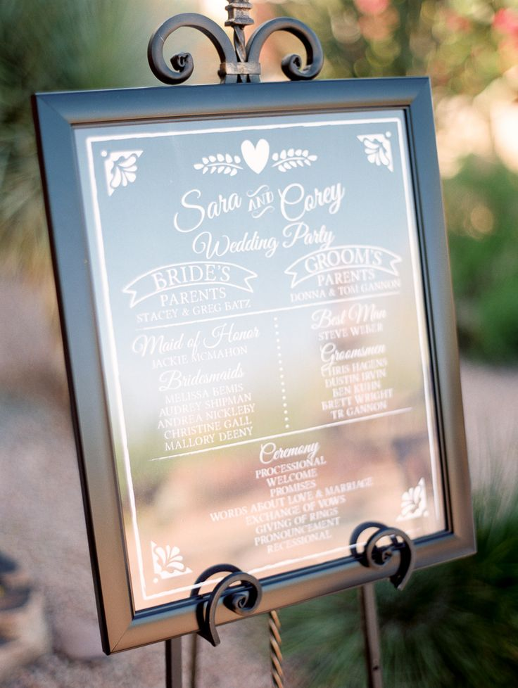 wedding ceremony sign vs. wedding programs