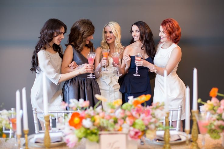 girls toasting at bridal shower brunch with mimosas