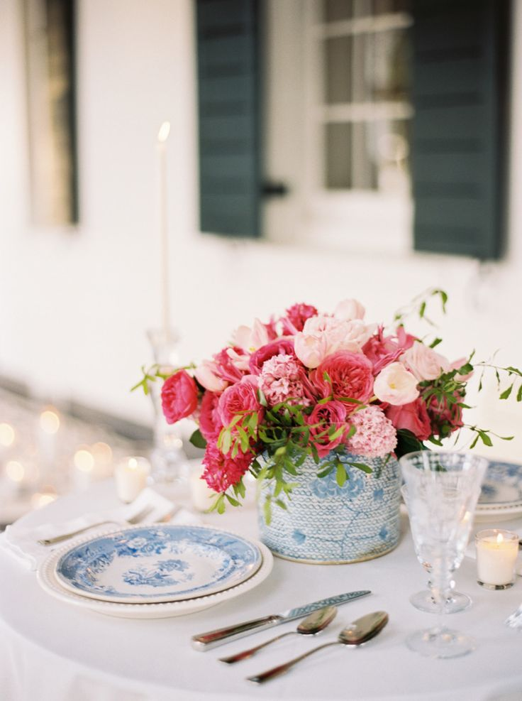 blue place setting with pink flowers