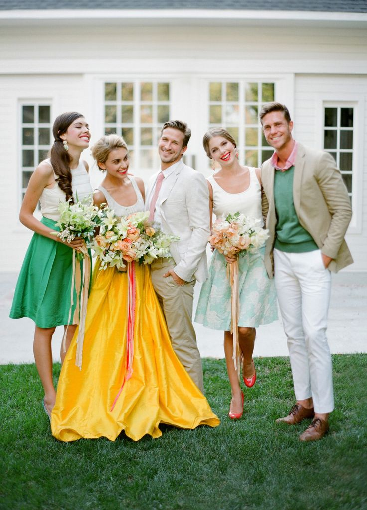 wedding guests in colorful outfits