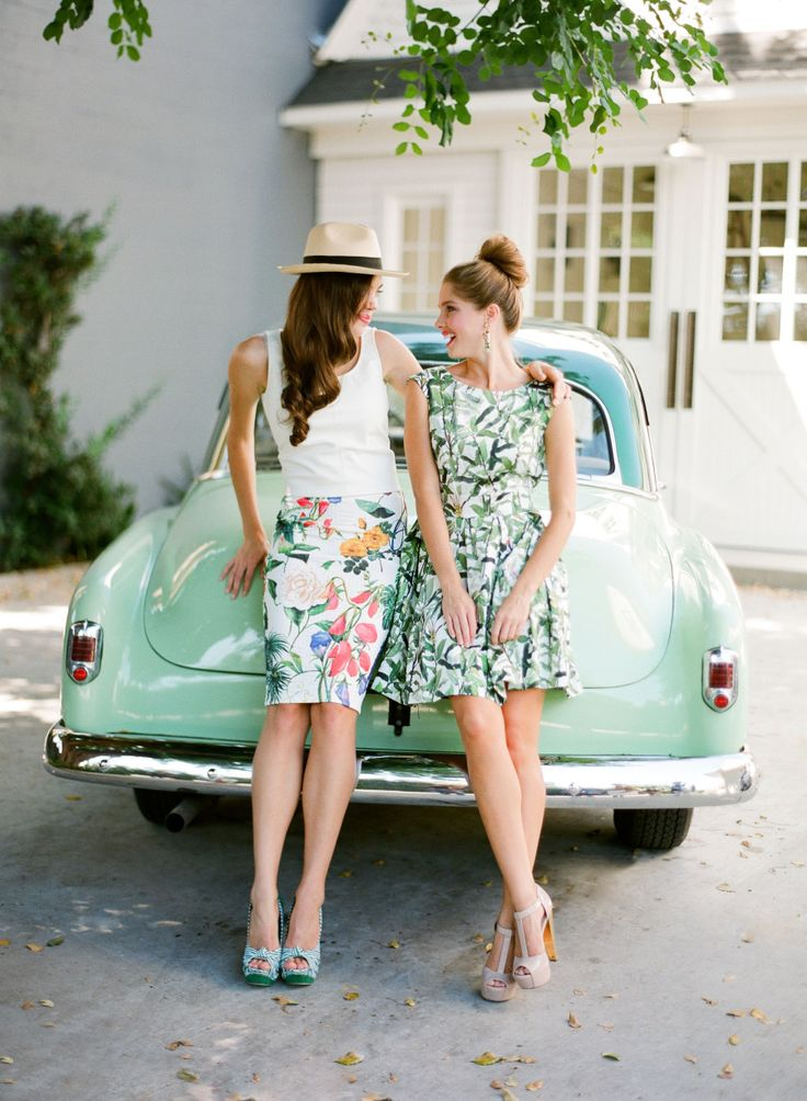 girls in scenic prints against a vintage car