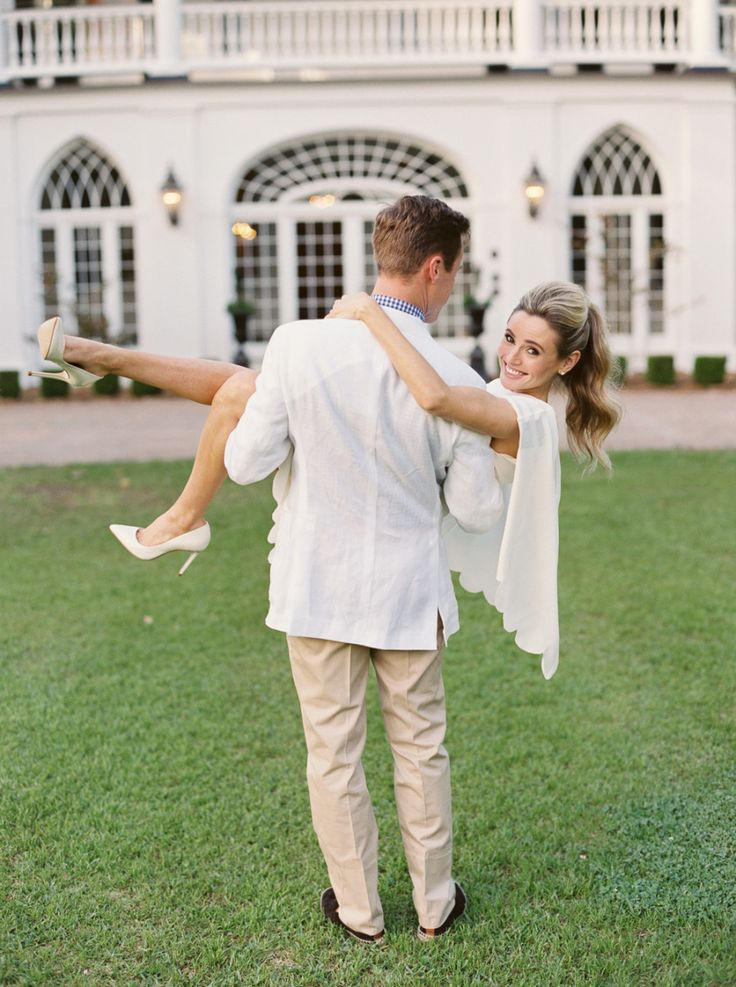 groom carrying bride, engagement session