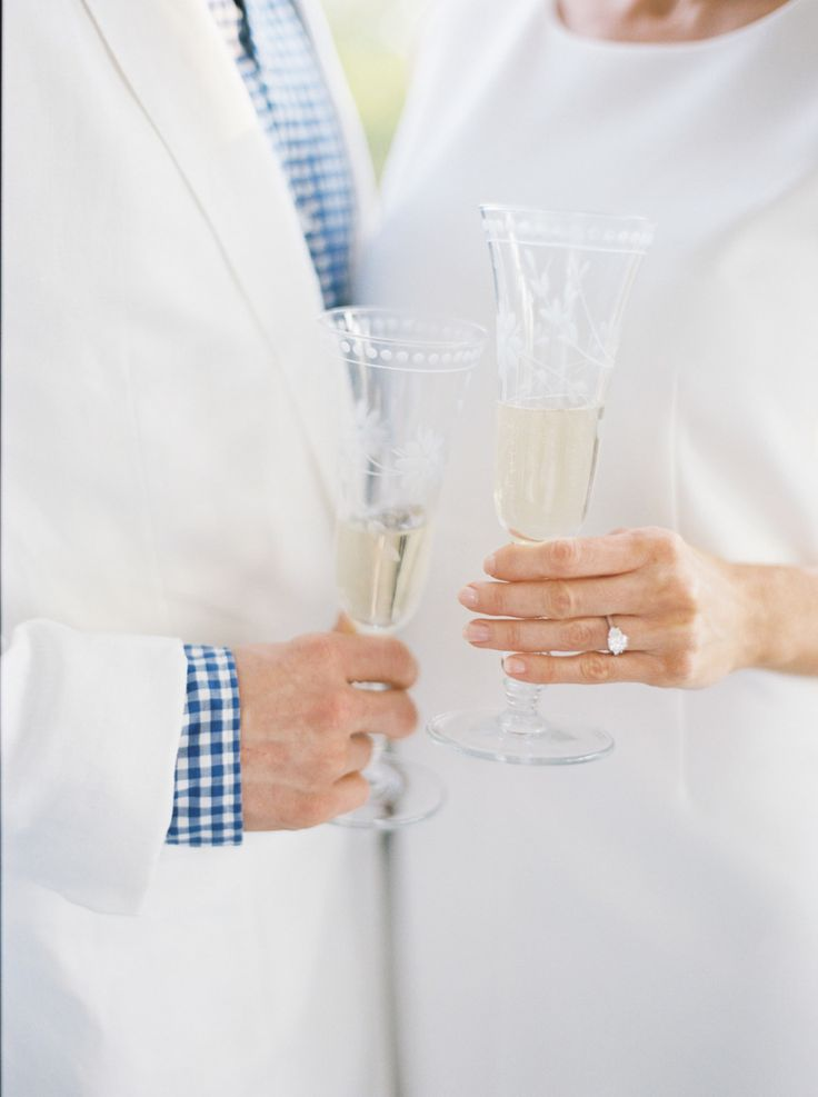 engaged couple sipping champagne