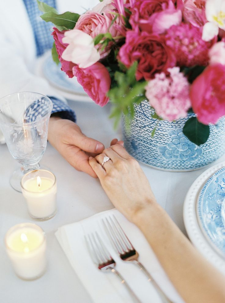 couple holding hands at the table