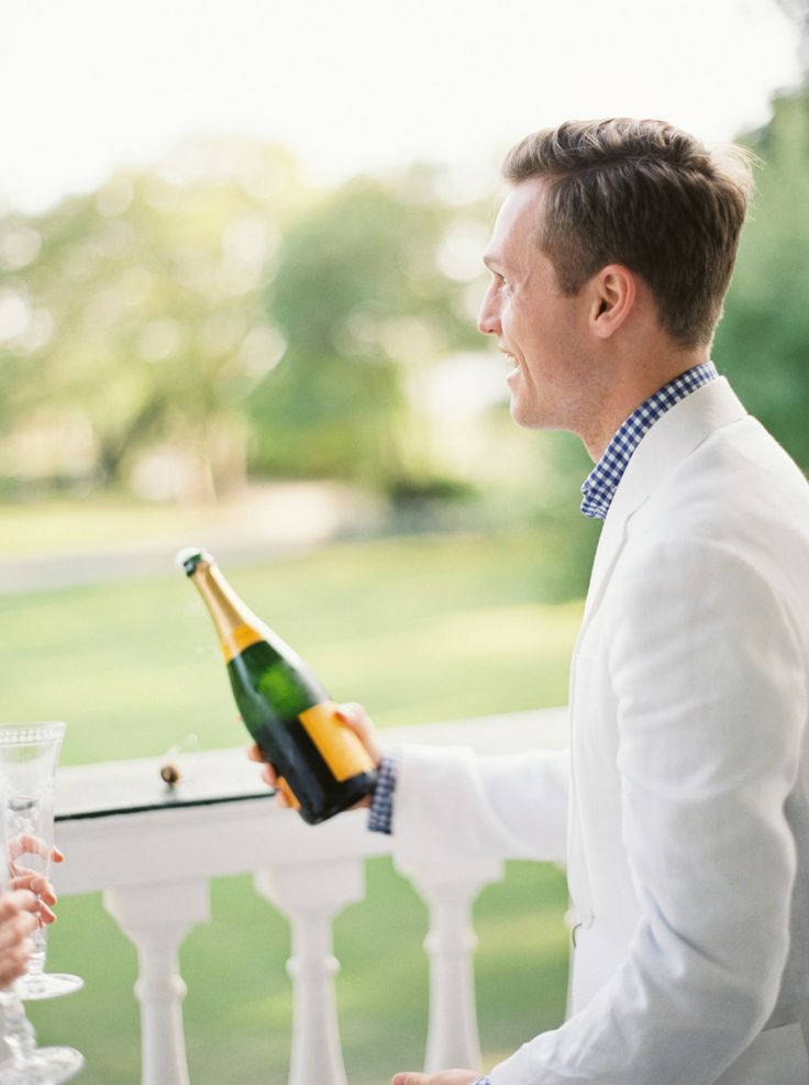 Southern gentleman opening champagne