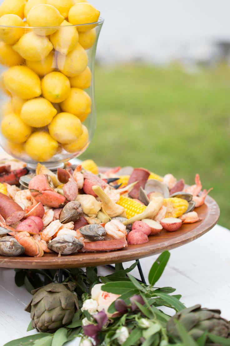 wedding seafood table with vase of lemons