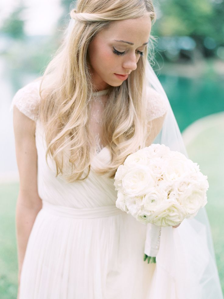 wedding dress with sheer top and boho hairstyle