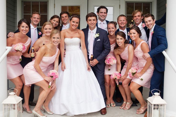 bridesmaids in pink short dresses and groomsmen in navy suits