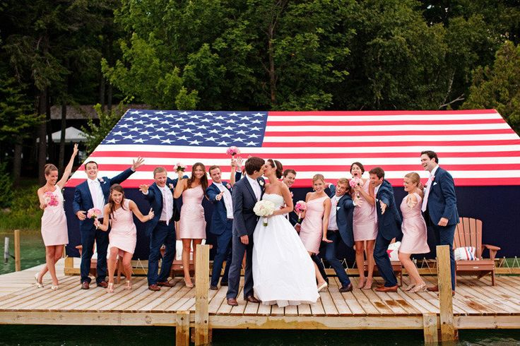 Bridal Party With American Flag Backdrop
