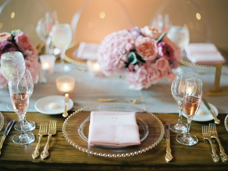 silver wedding reception table runner and pink low flowers