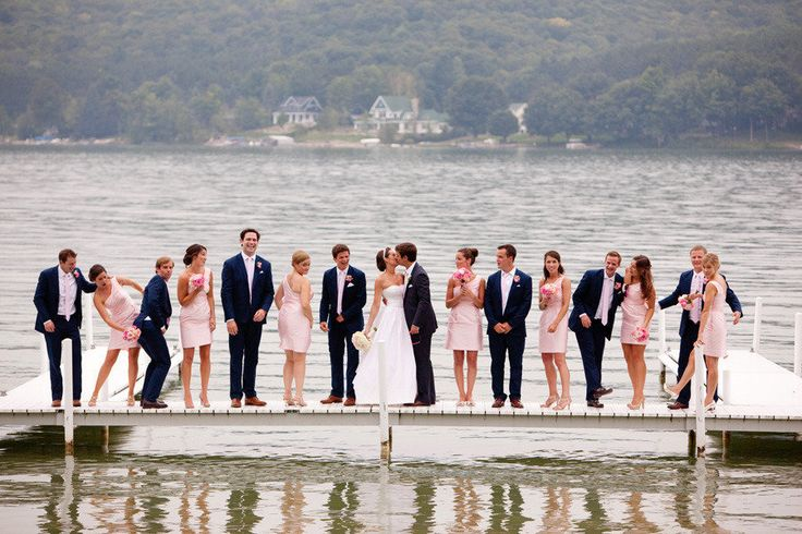 bridal party on a dock on a lake