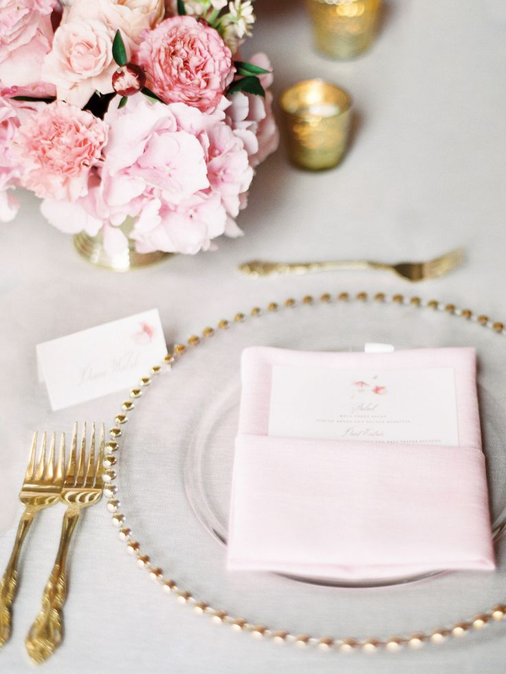 grey linens, gold flatware and pink flowers