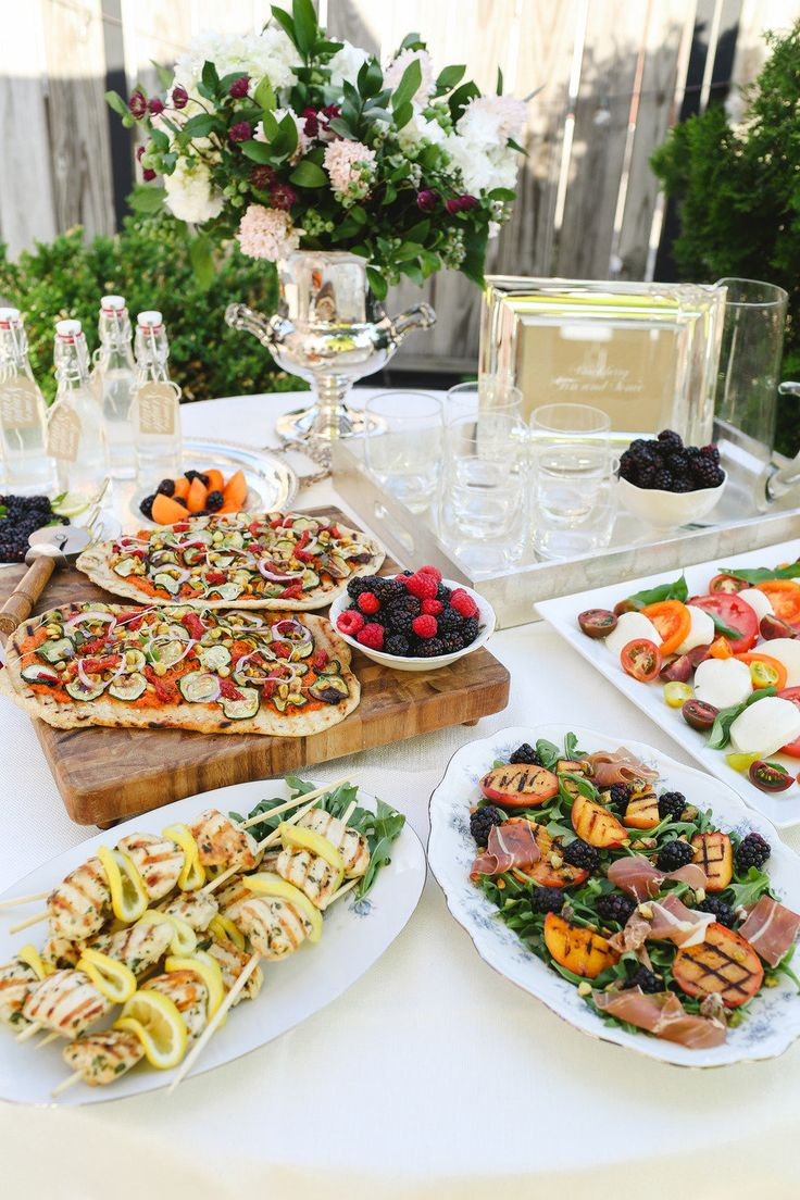 Engagement Dinner Party Ideas Part - 41: ... Engagement Party Girl Holding Board Of Pizzas Table With Flat Breads,  Chicken Dishes, Caprese Plate, Floral Bouquet And More! ...