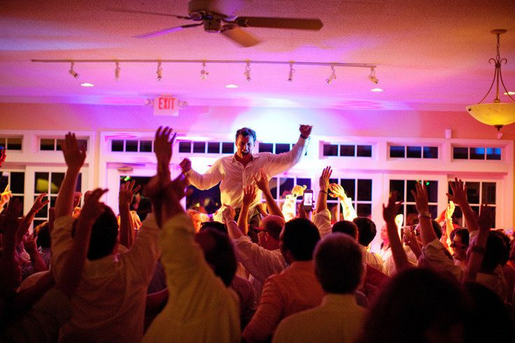 dance floor holding groom up in the air