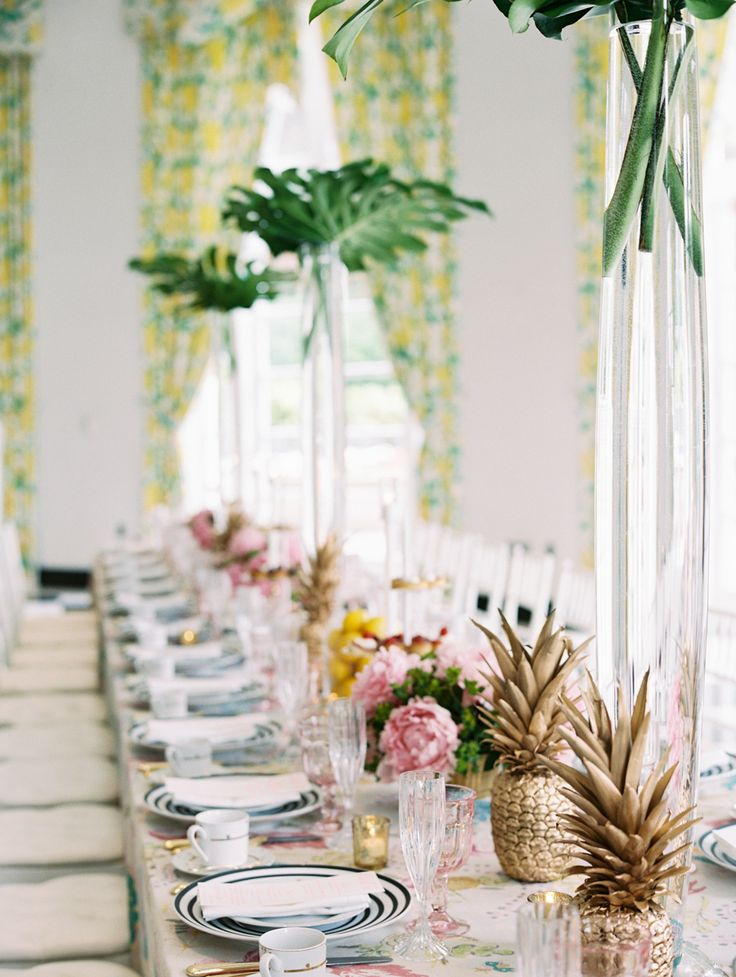 bridal shower kings table with palm trees, gold pineapples and patterned linens