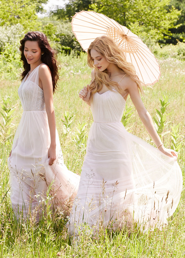 JH5557. Crystal bodice bridesmaids dresses. White bridesmaids dresses. Blossom English net A-line bridesmaid gown, draped curved neckline, natural waist with gathered skirt, tie detail at the back. http://itgirlweddings.com/occasions-fall-2015-collection/