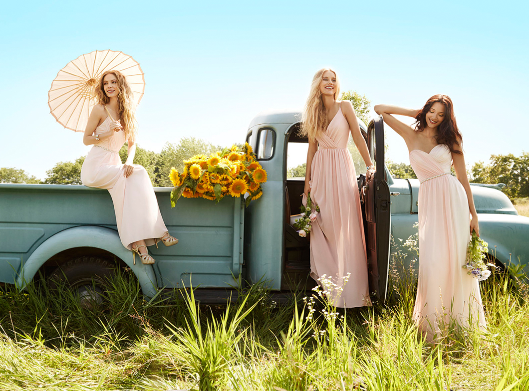 JH5563. Bridesmaids on a vintage truck in a field.Blush and Rose chiffon over Ivory lining strapless A-line bridesmaid gown, sweetheart draped bodice, natural waist with gathered skirt. http://itgirlweddings.com/occasions-fall-2015-collection/