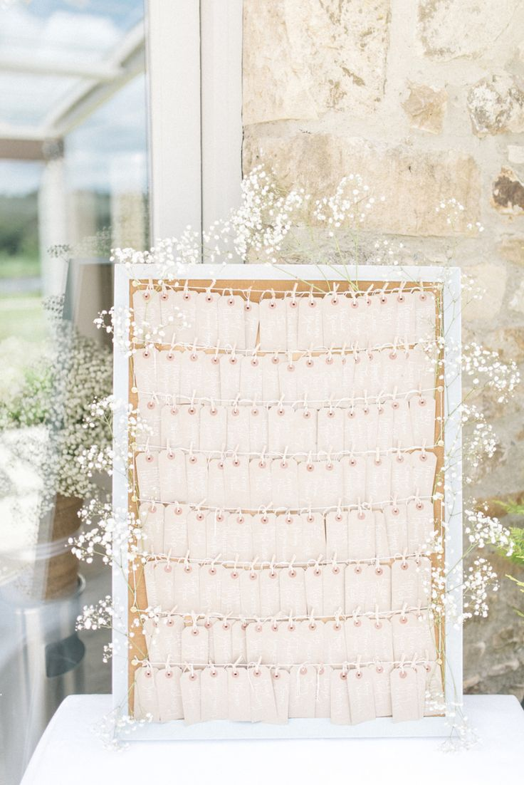 wedding place card sign with baby's breath